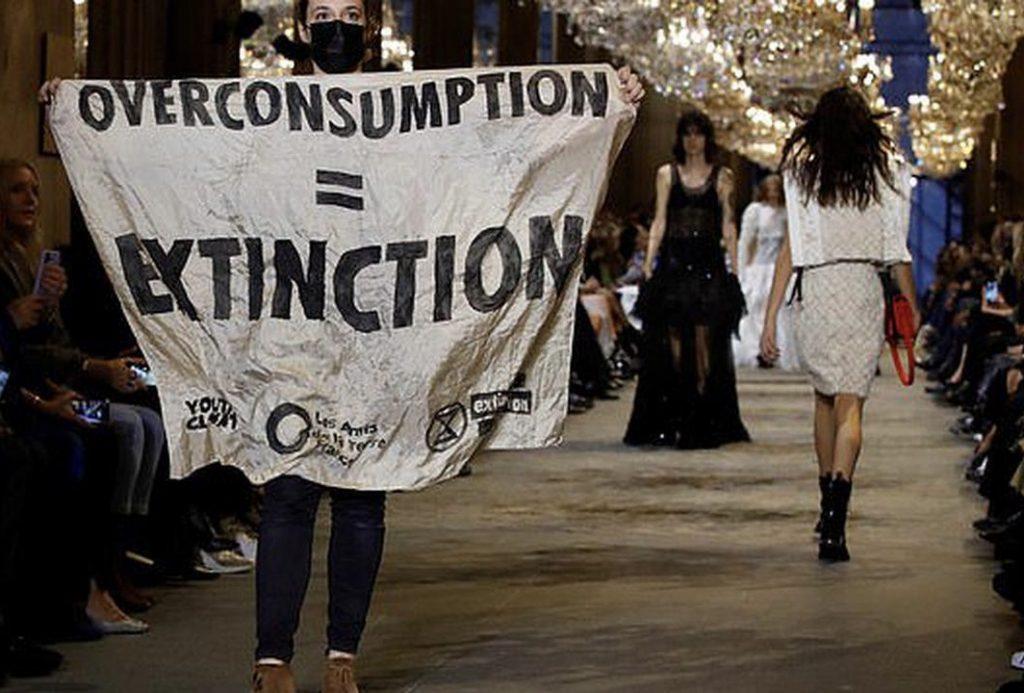 Overproduction protest at Louis Vuitton show